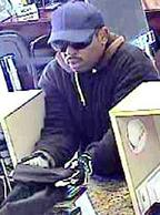 A bank robber who ran into a Chula Vista bank yelling  is being sought by the FBI and the Chula Vista Police Department.