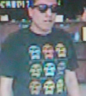 Law enforcement is seeking bank robber who likes to wear dark sunglasses and T-shirts, and used his smartphone as a demand note to rob banks in San Diego.