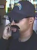 The FBI and San Diego Police Department seek the public's assistance to identify the unknown male responsible for robbing the Mission Federal Credit Union.