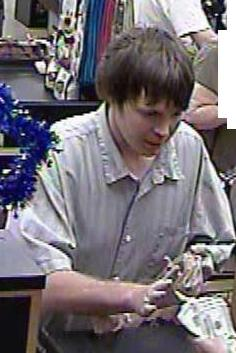 A bank robber who threatened to shoot a bank teller during a holdup at a Spring Valley, California bank is being sought by the FBI and San Diego Sheriffs Department.