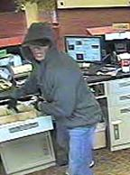 The FBI is seeking information regarding a bank robbery at the Illini Bank branch at 1311 West Jefferson, Auburn, Illinois.