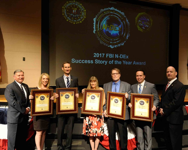 During a ceremony at the FBI's CJIS Division on August 29, 2017, members of the Las Vegas Metropolitan Police Department were presented with the 2017 National Data Exchange (N-DEx) Success Story of the Year award for their use of the N-DEx system in a sex trafficking investigation. (From CJIS Link article)
