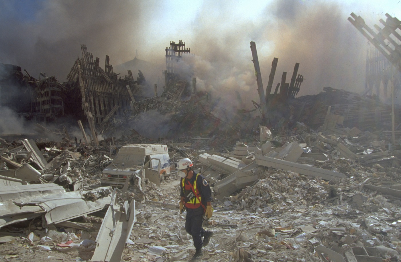 An emergency worker walks amid the rubble of the World Trade Center in Manhattan after the September 11, 2001, attacks.