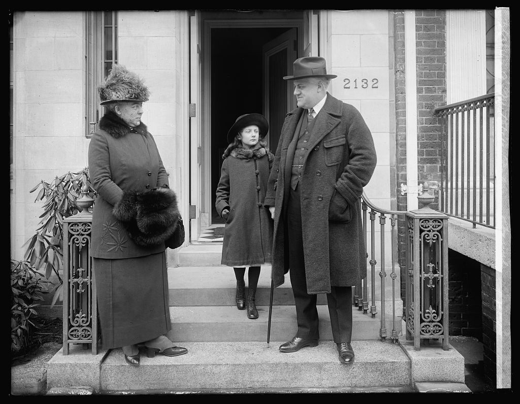 Black and white photograph of Attorney General A. Mitchell Palmer and his family standing outside their home in Washington, D.C., circa 1919. (Library of Congress photo)