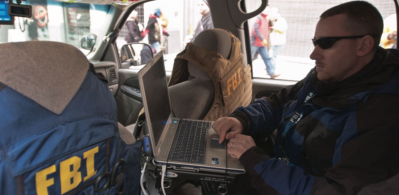Information Technology Fbi Agent Works On Laptop In Vehicle