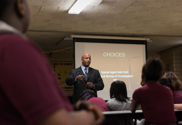 FBI Special Agent Rob Fortt speaks to students at Plato Learning Academy in Chicago on April 18, 2017.