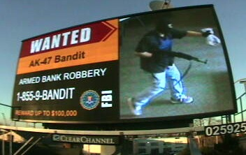 Digital billboards have helped publicize the case of the serial bank robber known as the AK-47 Bandit, who carries an assault rifle during take-over style robberies. The fugitive shot and wounded a California police officer during one robbery and since then has robbed or attempted to rob five more banks.
