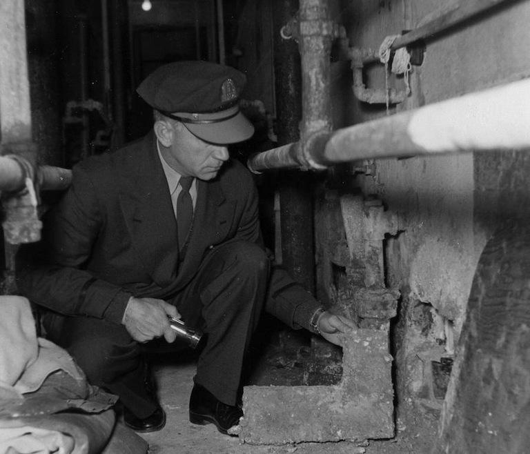 Guard Examines Hole Made by Alcatraz Escapees