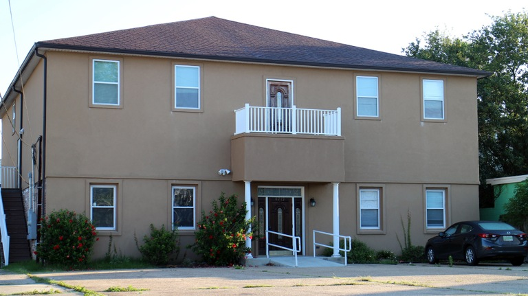 Image depicting the exterior of the New Orleans office of Alternatives Living, LLC, a non-profit housing organization.