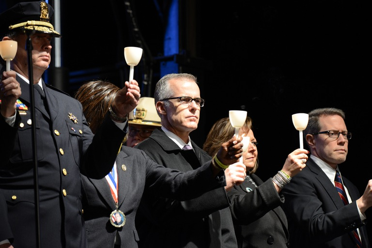 FBI Acting Director McCabe (center) joins other law enforcement officials during the 29th annual candlelight vigil on May 13, 2017 on the National Mall in Washington, D.C.