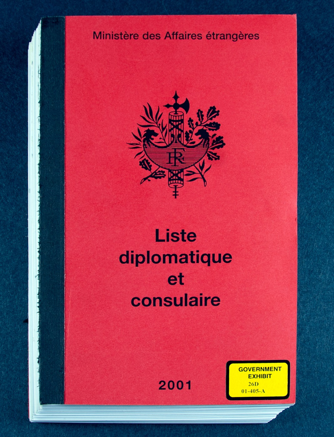 Photo of a copy of a booklet that lists contact information for foreign consulates that Brian P. Regan used to make selections of where to try and sell the classified information he had stolen. The booklet shown was used as an exhibit in Regan's trial.