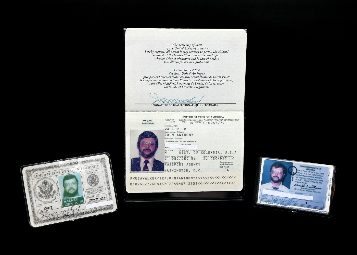 Photo of identification documents used by John Anthony Walker, Jr., including a driver's license, U.S. passport, and military ID. In 1985, Walker was arrested for selling U.S. secrets to the Soviet Union