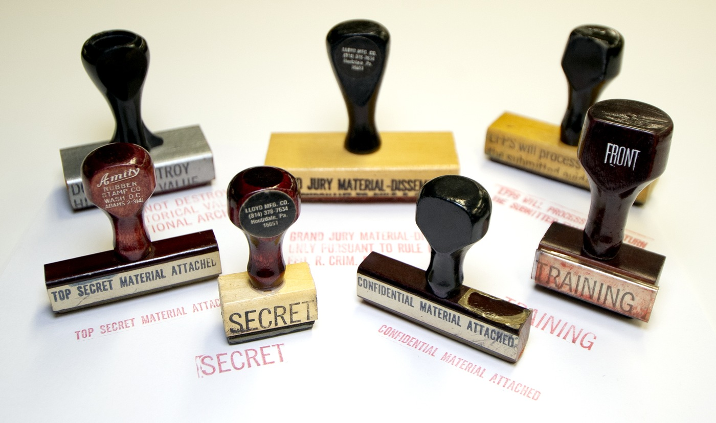 Photo of a collection of rubber stamps, formerly used to process FBI paperwork.