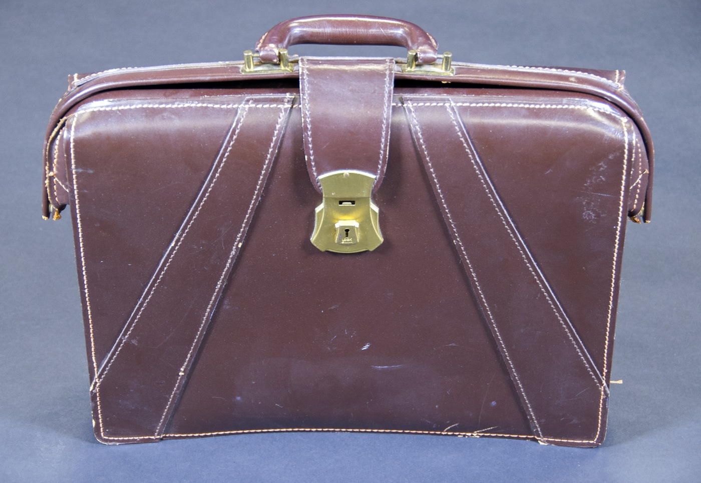 Photo of a brown leather briefcase that belonged to the first female FBI special agent.