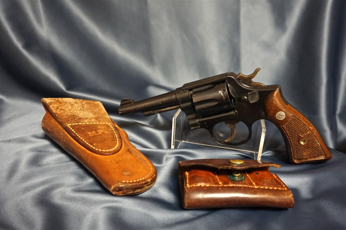 Photo of a gun next to a worn holster and ammo pouch, created exclusively for the FBI's S&W Model 10 M&P .38 revolver