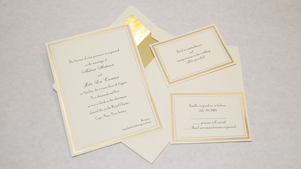 Photo of a wedding invitation on a table. The 2005 ruse wedding was used to get suspects in the same place, so they could be arrested.