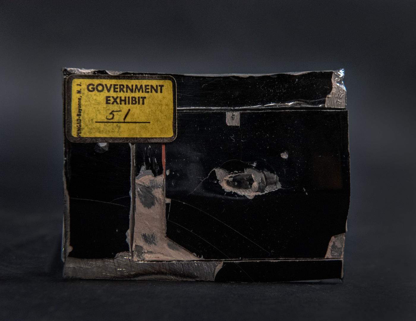 The FBI's March Artifact of the Month is a piece of the limousine struck during the assassination attempt.