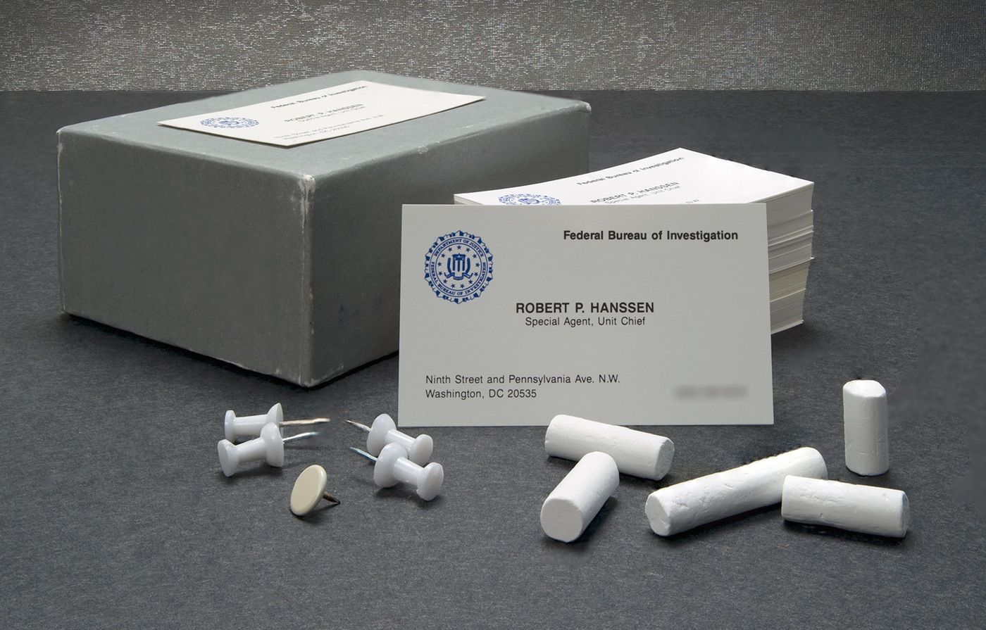 The May 2016 Artifact of the Month is Robert Hanssen's business cards and the chalk and thumbtacks he used to leave messages for his handlers while spying for Russia.