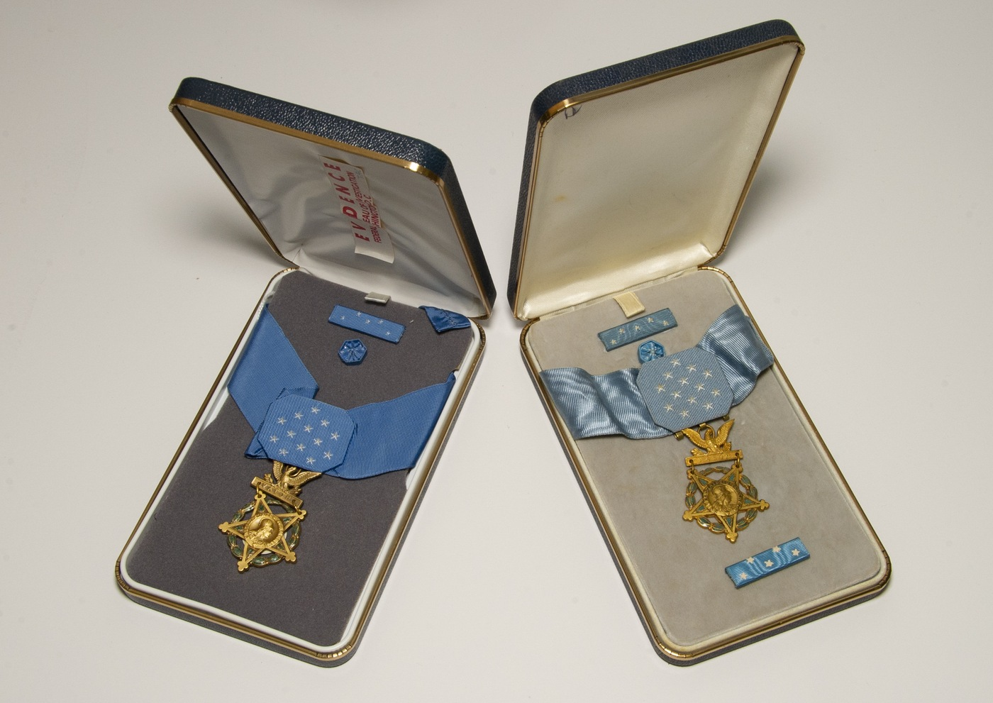 Photo of an unauthorized Medal of Honor (right) next to an authentic one (left). They were part of a 1990s FBI investigation into illegally manufactured Medals of Honor.