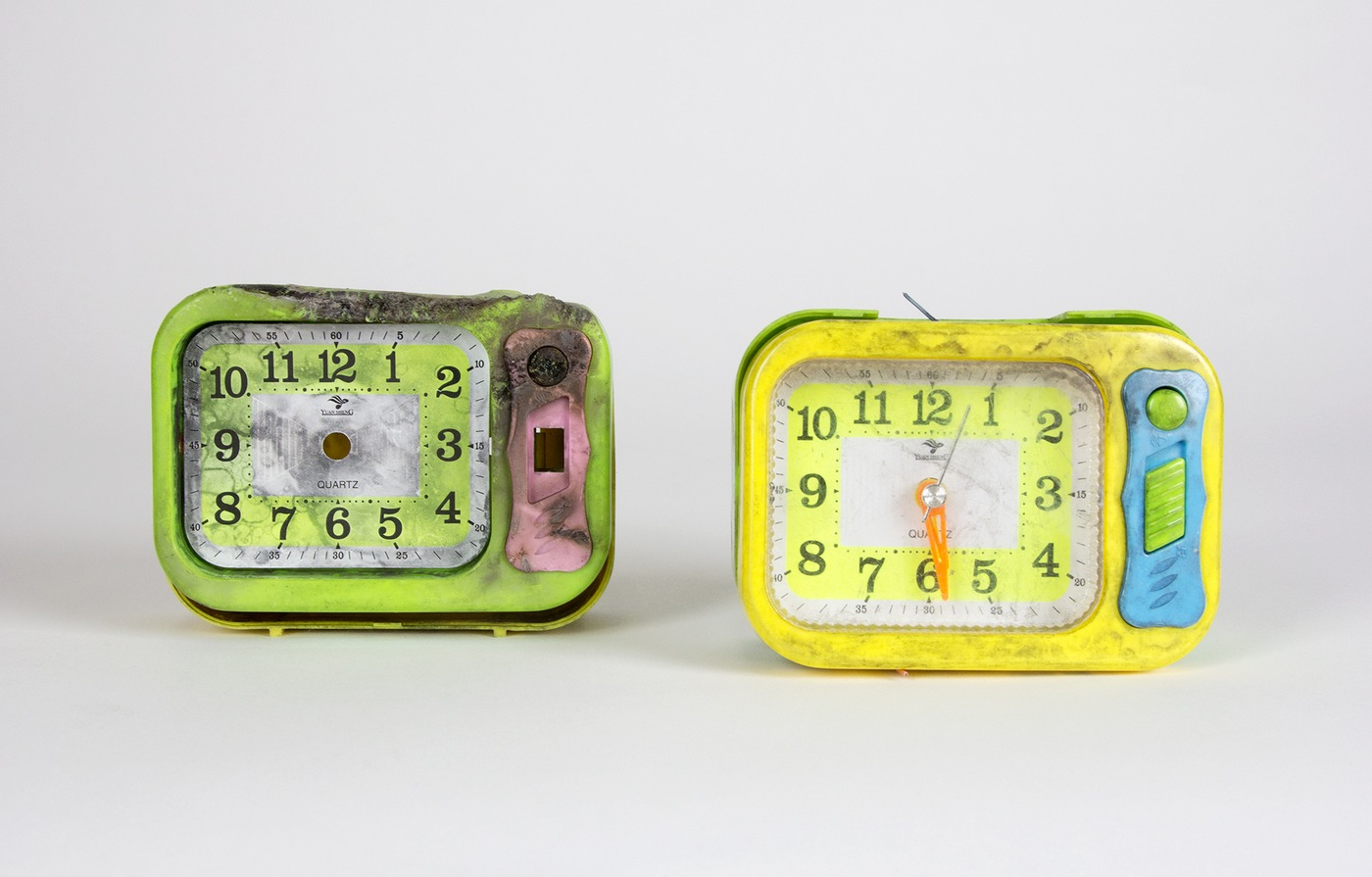 Photo of two damaged, neon-colored alarm clocks. They were part of a bomb that Faisal Shahzad planned to detonate in Times Square in 2010.