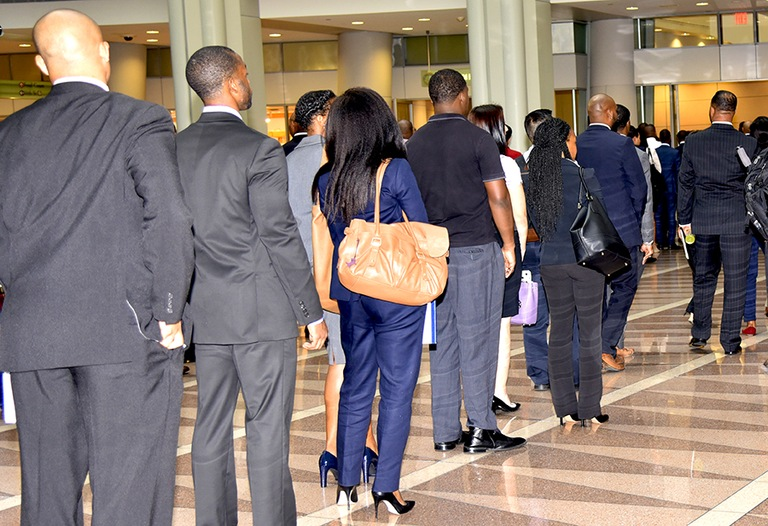 Queue of candidates gathering in Washington, D.C. for qualified special agent candidates of different racial and ethnic backgrounds