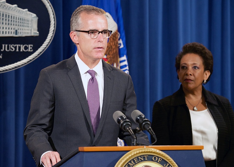 Washington Field Office Assistant Director in Charge Andrew McCabe and Attorney General Loretta Lynch take part in a May 20, 2015 press conference announcing the guilty pleas of and criminal fines against five global financial institutions involved in market manipulation.