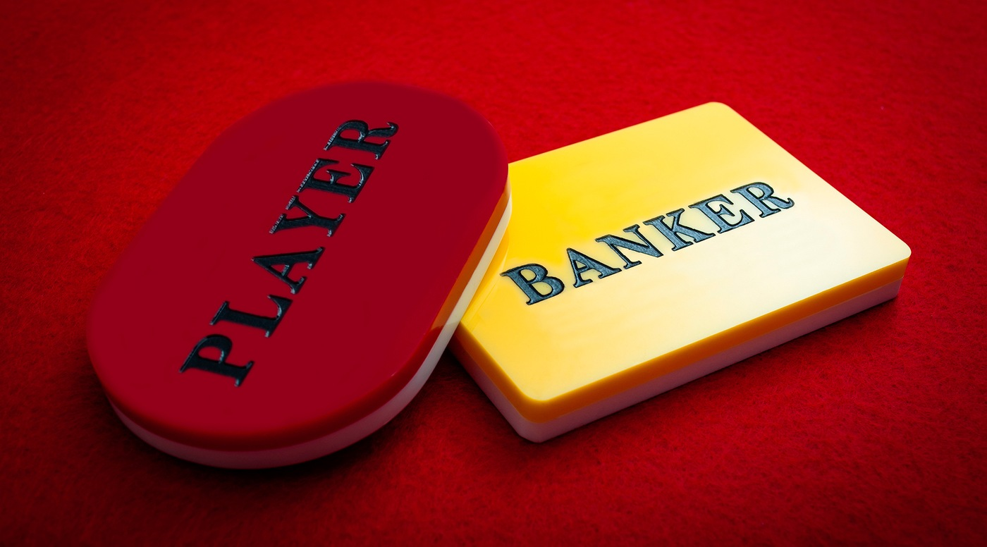 Stock image depicting baccarat betting chips with the words Player and Banker.