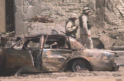 Car Bombing in Baghdad in August 2003 (AP Photo)