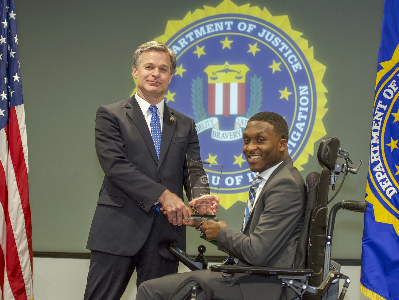 FBI Director Christopher Wray presents Baltimore Division recipient Van Brooks with the Director's Community Leadership Award (DCLA) at a ceremony at FBI Headquarters on May 3, 2019.
