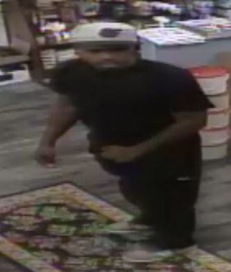 One of two individuals who committed an armed robbery of Clyde's Sport Shop at 2307 Hammonds Ferry Road in Baltimore, Maryland on April 6, 2016.