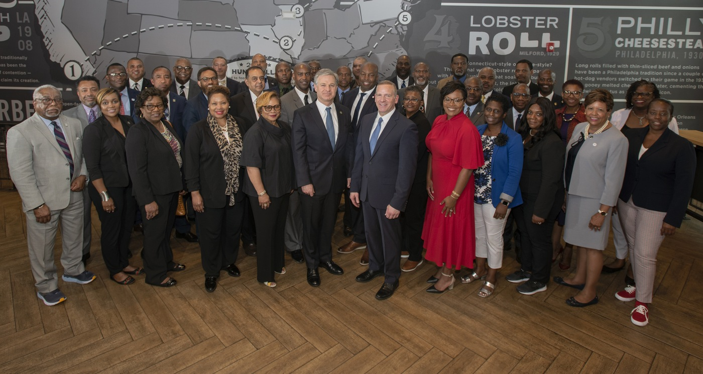 Director Christopher Wray and Deputy Director Paul Abbate pose with a group of Historically Black College and University presidents and FBI senior officials at the FBI's Beacon kickoff dinner June 29.