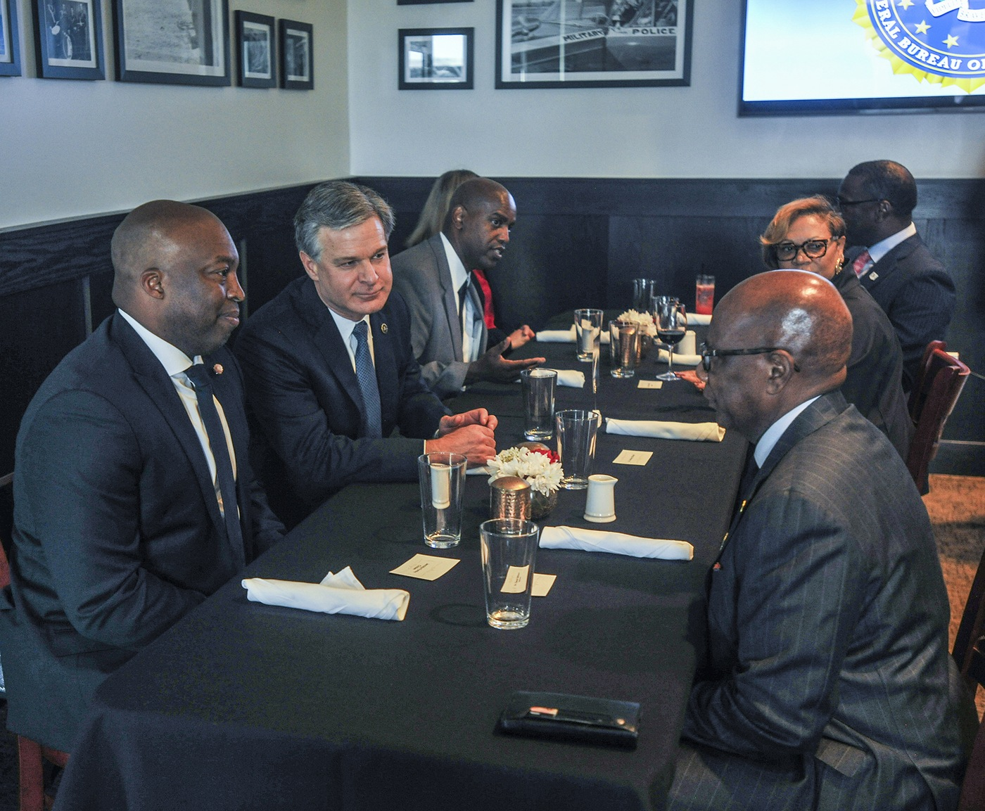 Director Christopher Wray talks with Historically Black College and University officials during a dinner as part of the FBI's Beacon kickoff June 29, 2021.