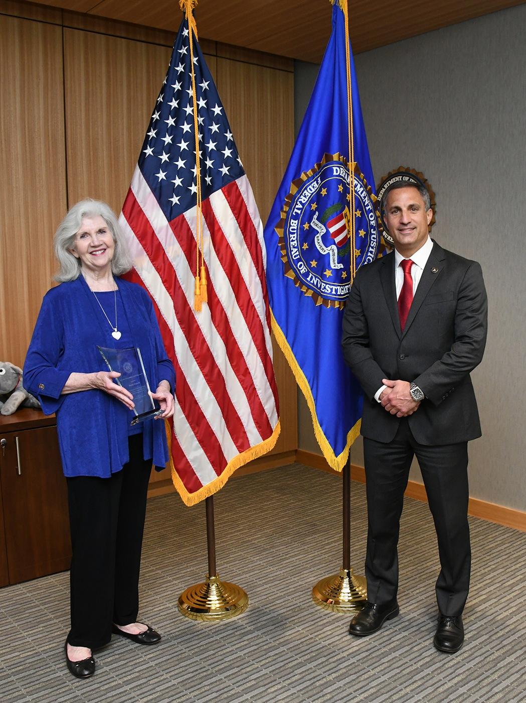 FBI Boston Director's Community Leadership Award recipient Sheila Duncan poses with Boston Special Agent in Charge Joseph Bonavolonta.