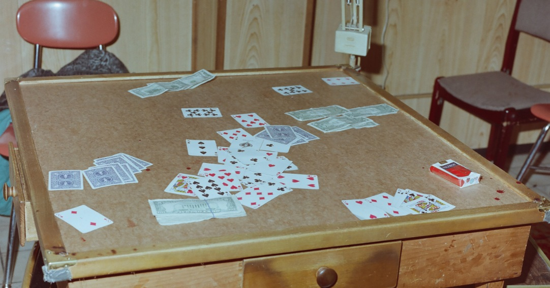 Card table in social club on Tyler Street as seen in 1991. Hung Tien Pham is wanted for his alleged involvement in the execution-style murders of five men at the Chinatown social club in Boston,