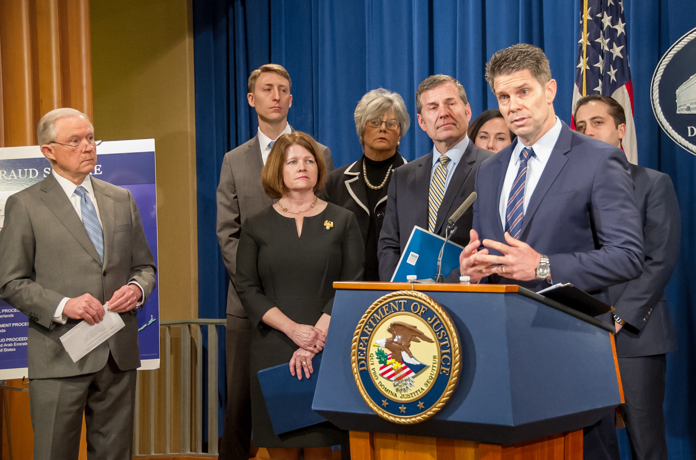 FBI Acting Deputy Director David Bowdich speaks at a February 22, 2018 press conference announcing elder fraud charges as Attorney General Jeff Sessions and others look on.