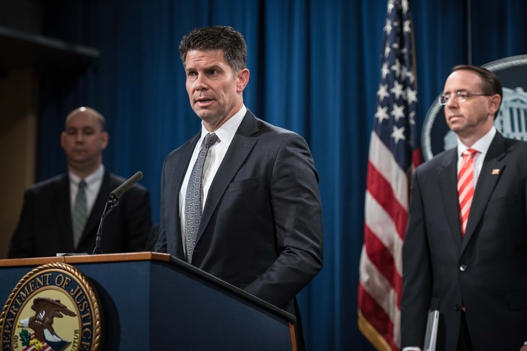FBI Deputy Director David Bowdich speaks at a March 23, 2018 press conference announcing hacking-related charges against nine Iranians as Deputy Attorney General Rod J. Rosenstein and FBI New York Assistant Director in Charge William F. Sweeney, Jr. look on.