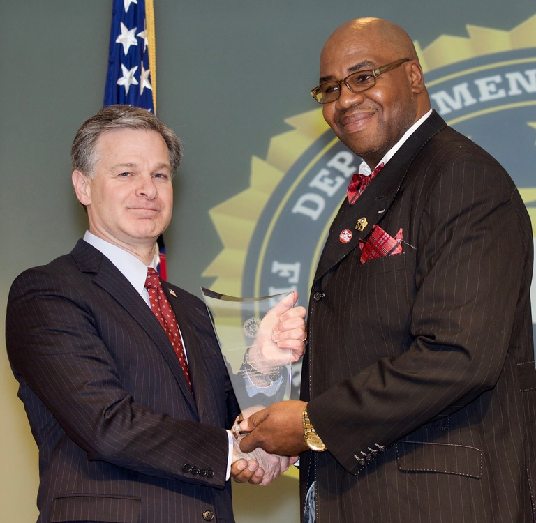 FBI Director Christopher Wray presents Buffalo Division recipient Murray Holman with the Director's Community Leadership Award (DCLA) at a ceremony at FBI Headquarters on April 20, 2018.