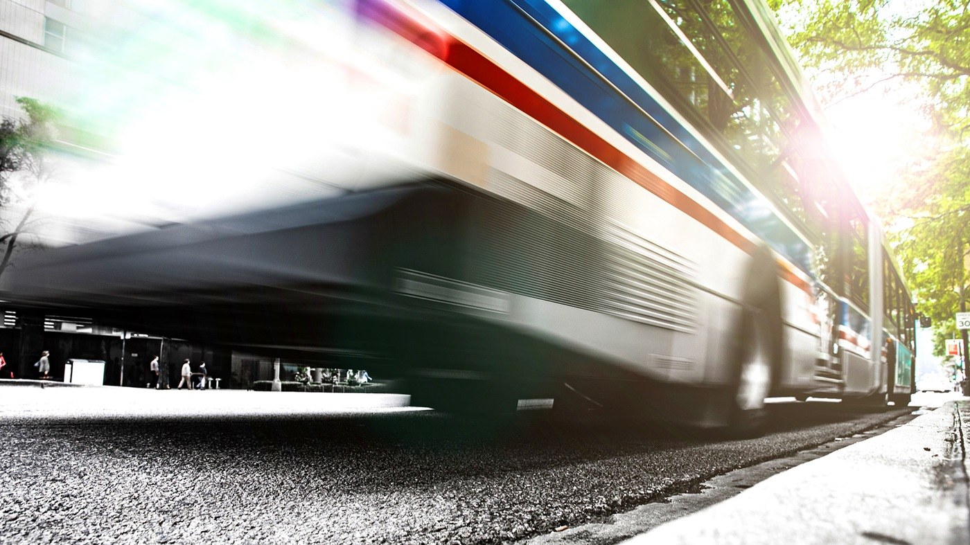 Stock image depicting a bus in motion.