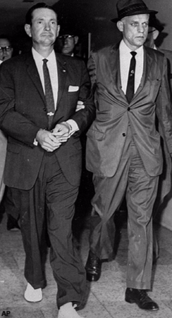 Byron De La Beckwith (Left) Is Escorted into the Jackson Police Station by FBI agents on June 23, 1963 (AP Photo)