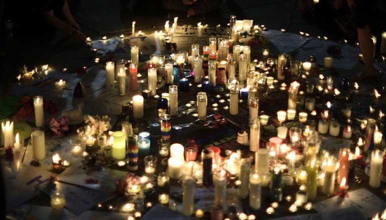 Stock image depicting candles at a memorial.