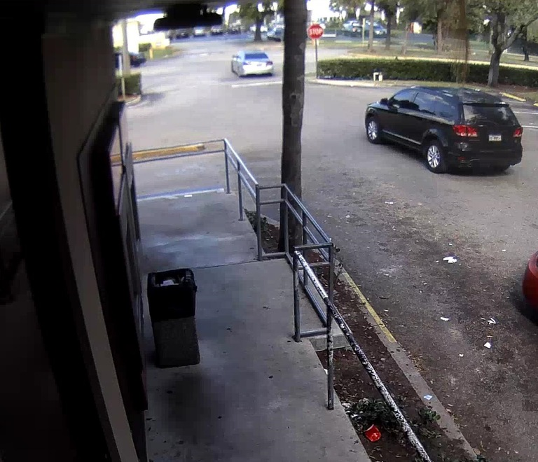 Carjacking Image 3 Toyota Camry leaving a parking lot being followed by the Dodge Journey