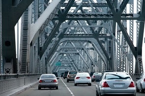 Stock image of cars driving over bridge (from CJIS Link article).