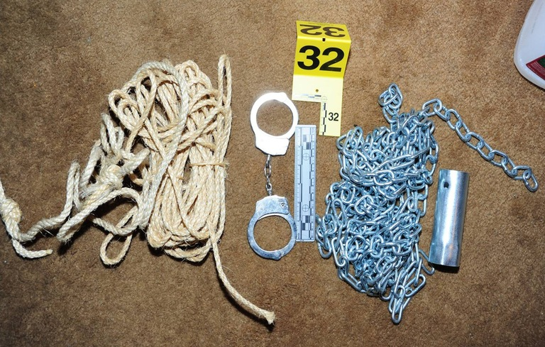 Evidence seized in the human trafficking case, such as these restraints, revealed that the subjects were fully prepared to buy kidnapped women and hold them against their will.