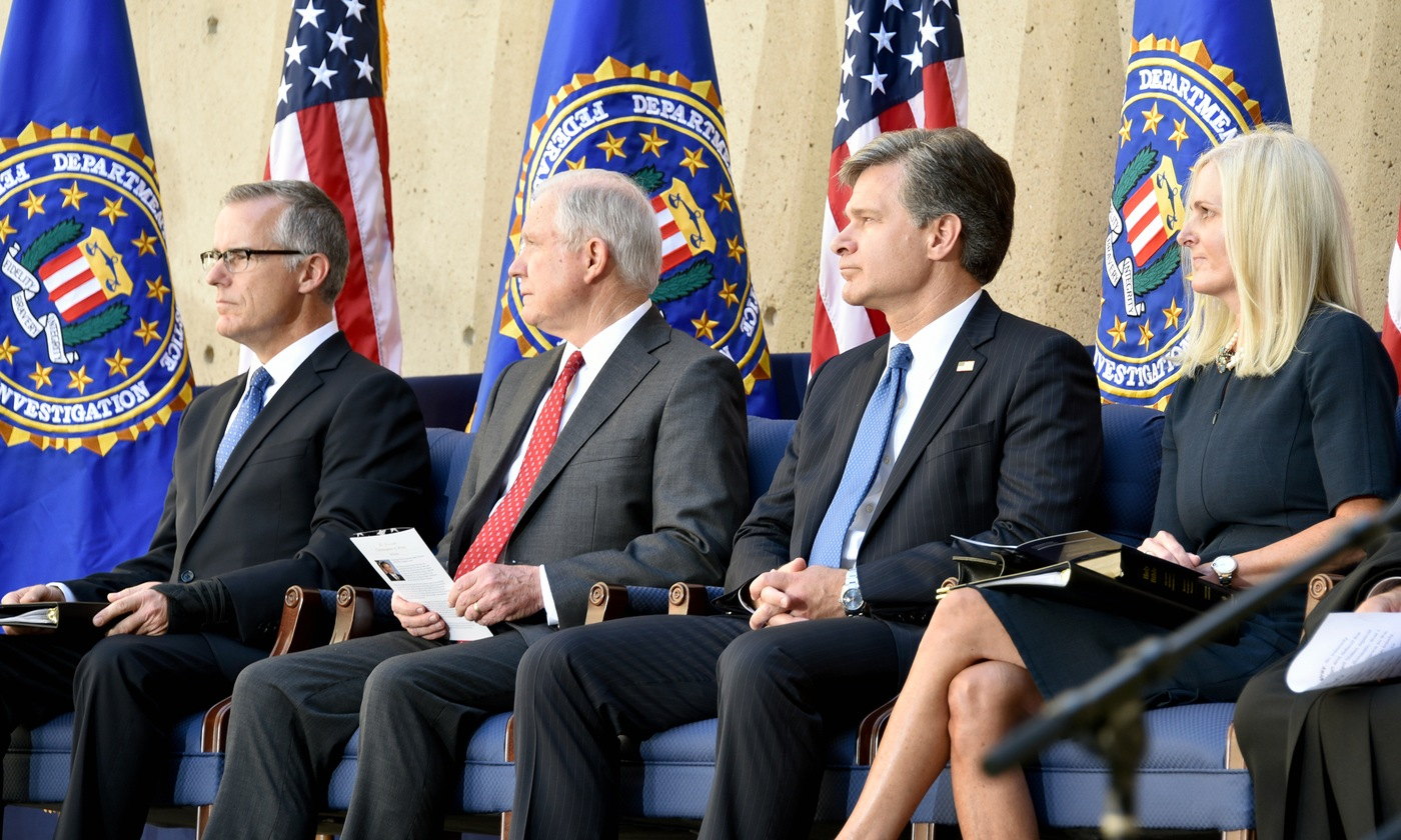 FBI Deputy Director Andrew McCabe, Attorney General Jeff Sessions, FBI Director Christopher Wray, and Helen Wray sit on stage at Wray's installation ceremony at FBI Headquarters in Washington, D.C. on September 28, 2017.