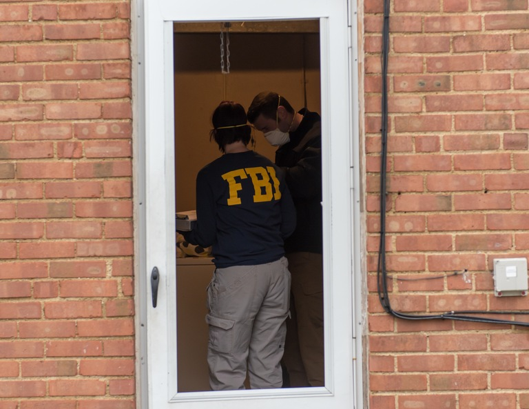FBI Agents at a Home in Cleveland During Operation Disarray