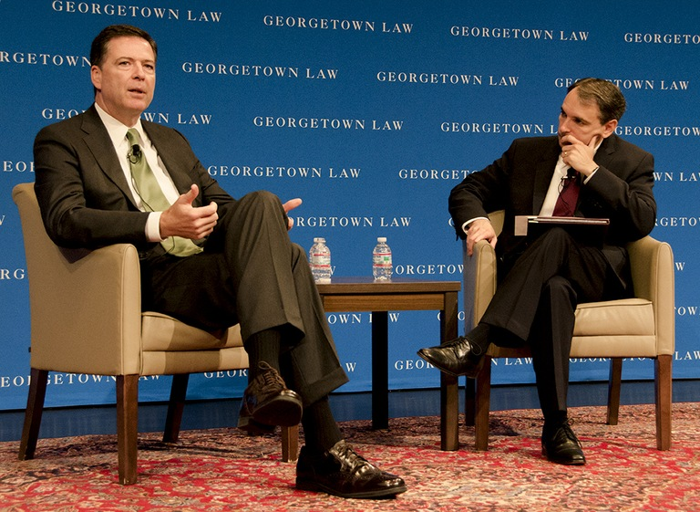 FBI Director James Comey discusses cyber threats with interviewer Benjamin Powell at the Cybersecurity Law Institute at Georgetown Law Center.