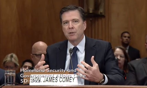 FBI Director James Comey briefs members of the Senate Committee on Homeland Security and Governmental Affairs on current threats to the homeland on October 8, 2015.