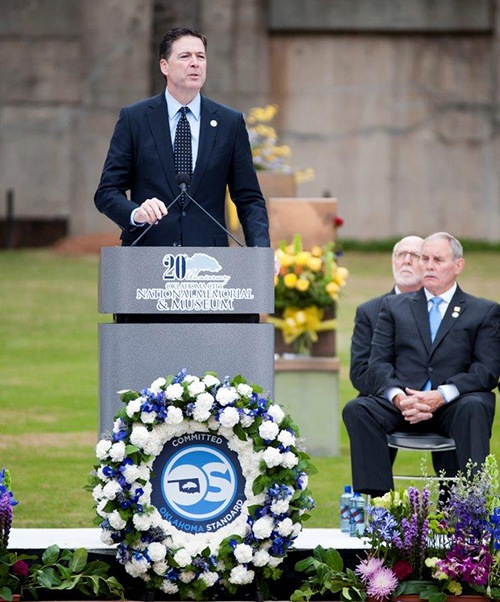 Director Comey speaks at a memorial service marking the 20th anniversary of the bombing.