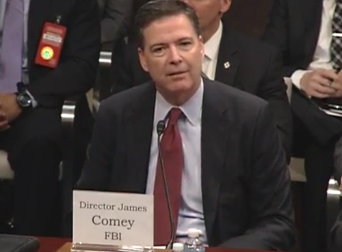 FBI Director James Comey answers questions from members of the U.S. House Permanent Select Committee on Intelligence during a hearing on worldwide cyber threats on September 10, 2015.