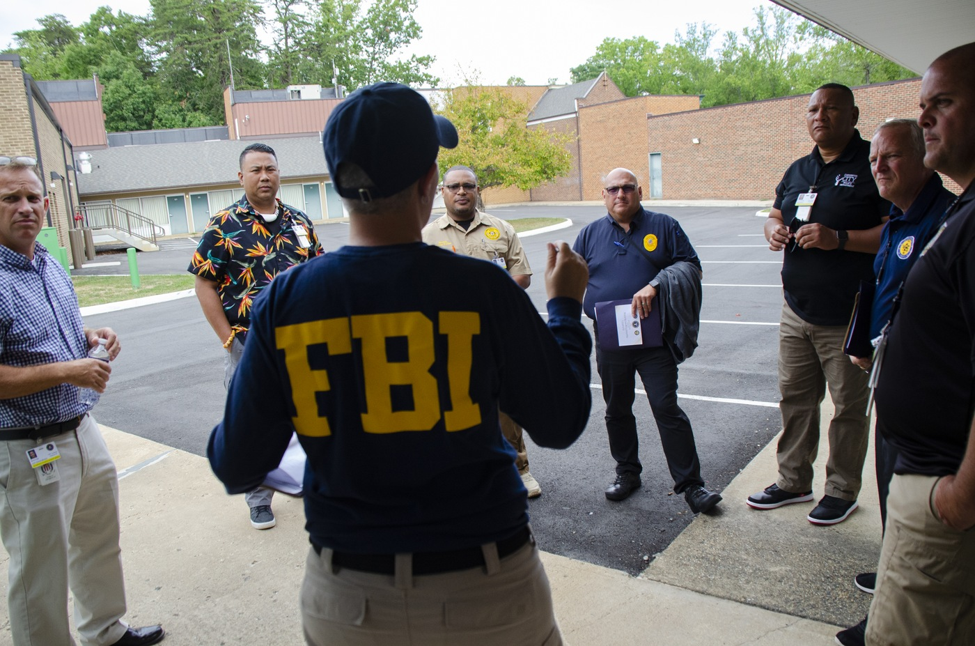 Rebecca Elam, a Victim Services Division program manager, briefs visiting command police officers during a September 25, 2019, mass-casualty exercise at the FBI Training Academy in Quantico, Virginia. The exercise culminated ELEVATE-APB training for victim service providers.